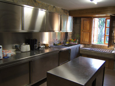 Fully fitted kitchen with modern stainless steel furniture